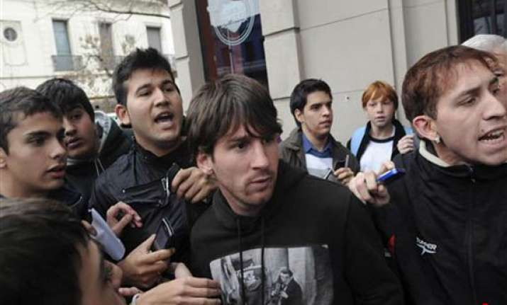 schoolboy throws punch at messi