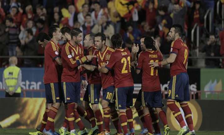 spain a point away from world cup qualification