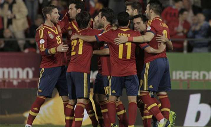 spain beats belarus 1 point away from world cup