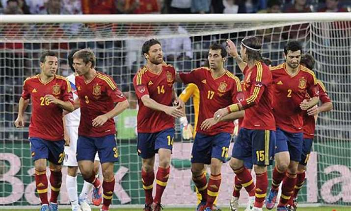 spain pressured to retain euro title amid crisis