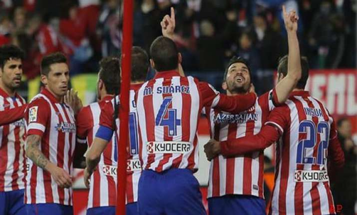 spanish league atletico goes top for 1st time since 96