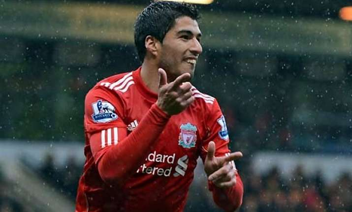 suarez scores from near halfway for hat trick