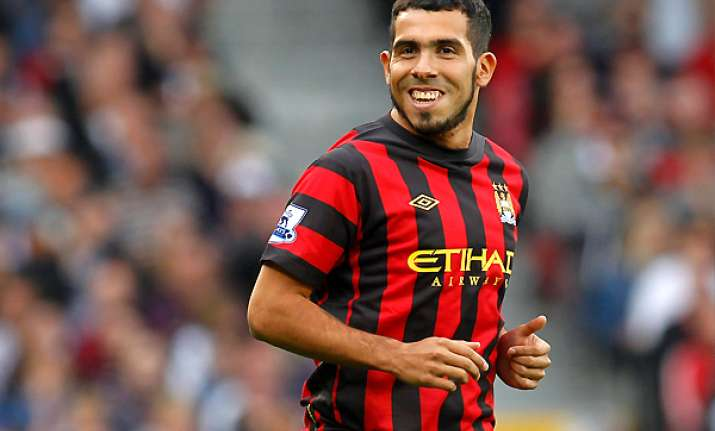 tevez could play for man city in 2 weeks says mancini