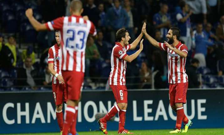 turan goal gives atletico madrid 2 1 win at porto