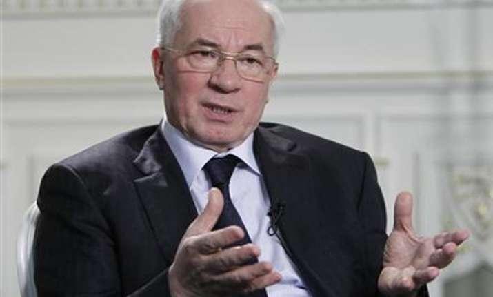 ukraine premier sees ball cross line