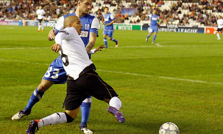 valencia routs genk 7 0 to set up chelsea clash
