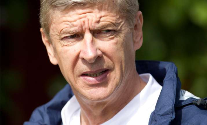 wenger gets two match touchline ban from uefa
