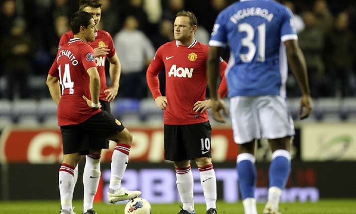 wigan inflicts shock 1 0 loss on man united