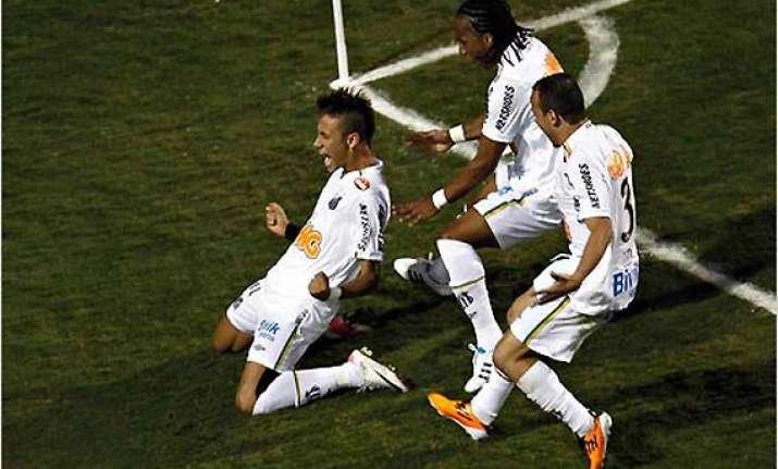 young santos stars lead libertadores win