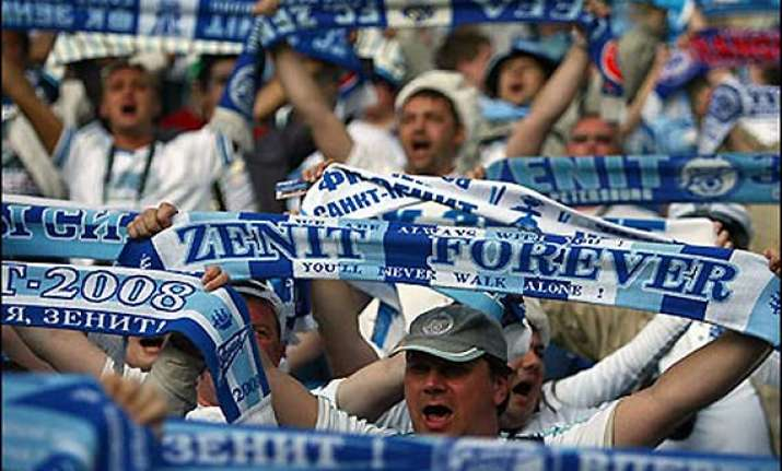 zenit beat ac milan to secure europa league berth
