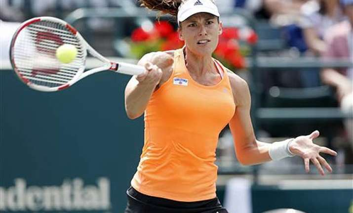 andrea petkovic rallies past eugenie bouchard in 3 sets at