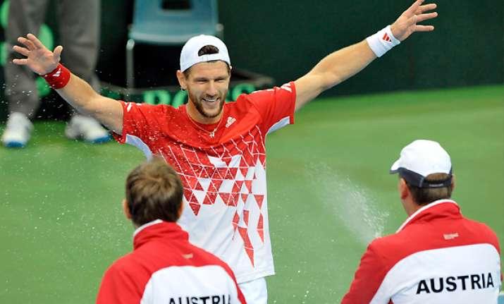 austria beats russia to reach davis cup quarters