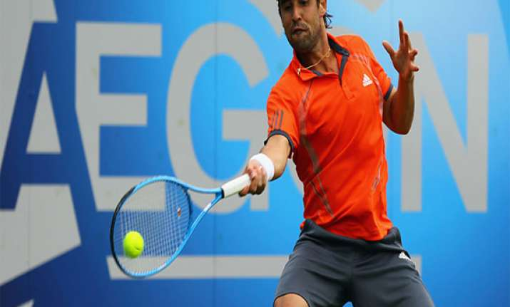 baghdatis wins in first round at eastbourne