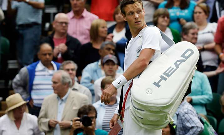 berdych loses to gulbis in 1st round of wimbledon