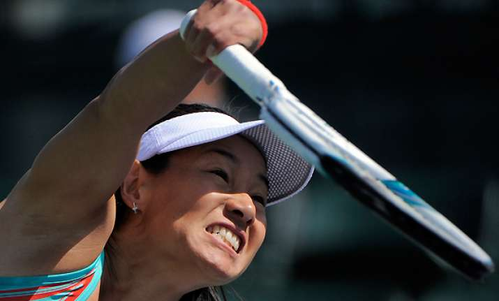date krumm wins on blustery day at indian wells