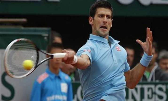 djokovic sharapova reach 2nd round at french open