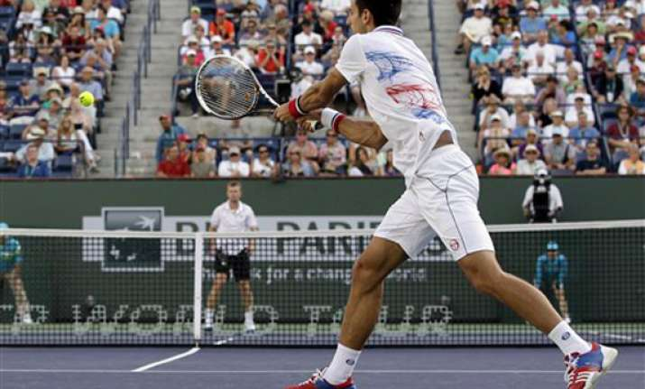 djokovic earns victory over qualifier