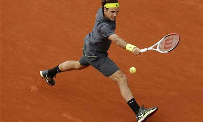 djokovic federer move on at french open