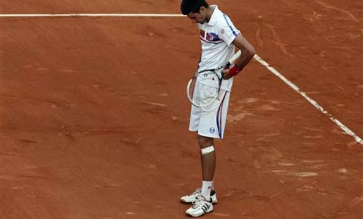 djokovic pulls out of queen s tournament