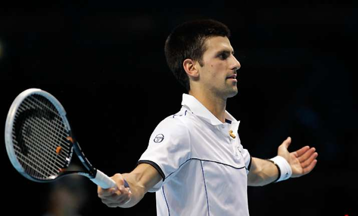 djokovic recovers to beat berdych at atp finals