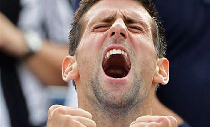djokovic steps up to dominate men s tennis in 2011