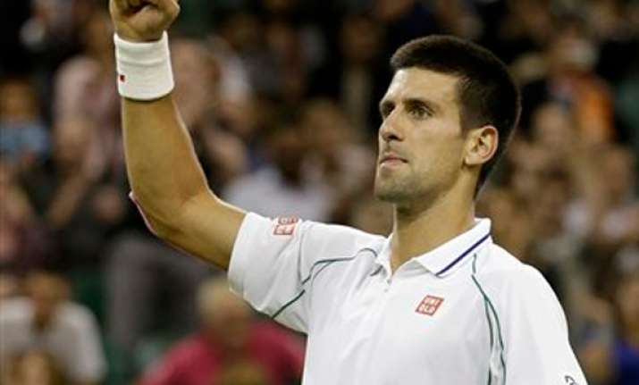 djokovic beats harrison under wimbledon lights