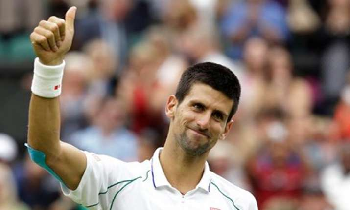 djokovic rallies past stepanek at wimbledon