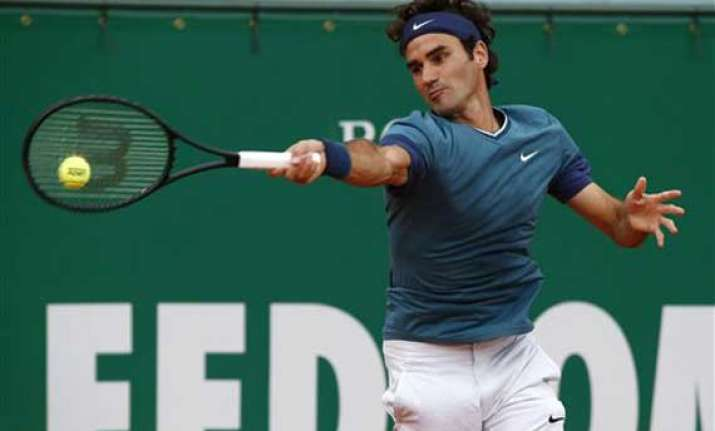 federer eases into monte carlo masters 3rd round