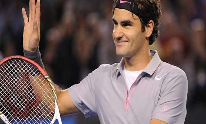 federer trying to re energize game in cincinnati
