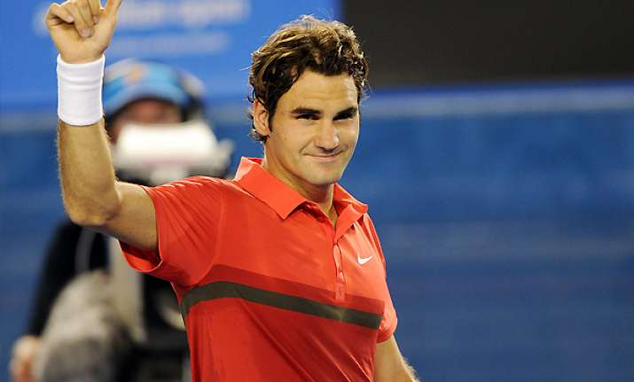 federer advances to 3rd round with walkover