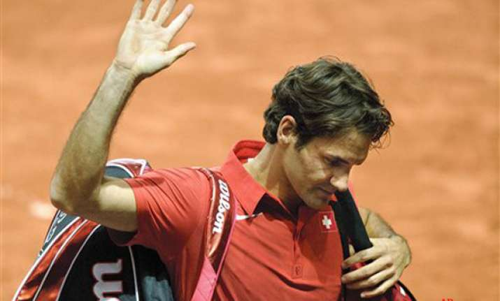 federer and swiss knocked out by us in davis cup