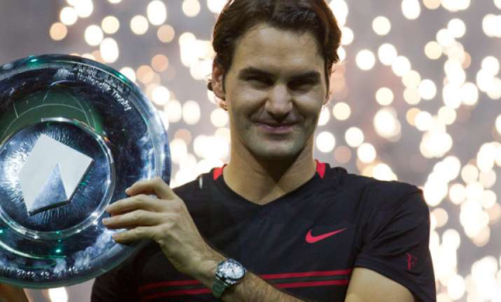 federer beats del potro to clinch abn amro title