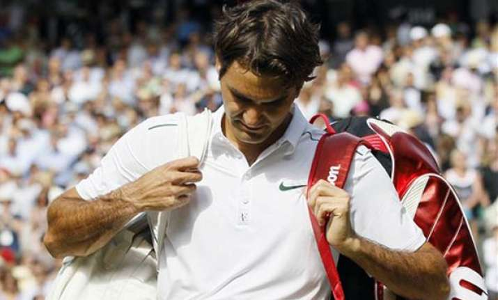 federer loses to tsonga in wimbledon quarterfinals
