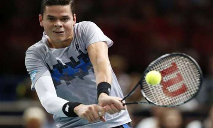 raonic downs federer at paris masters