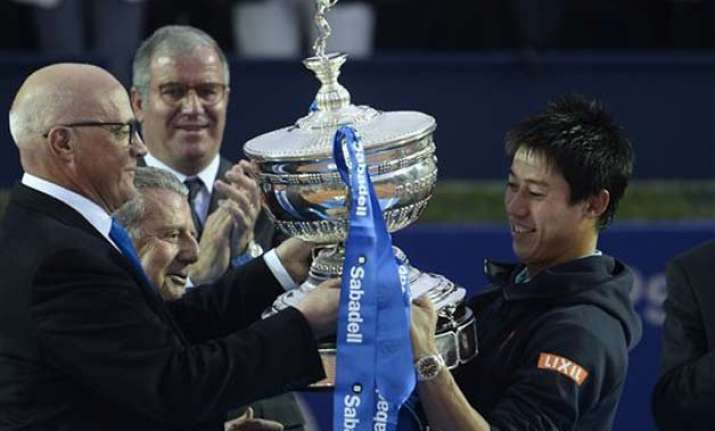nishikori beats andujar to defend barcelona open title