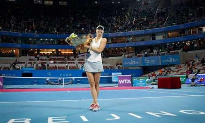 sharapova wins china open back to world number 2