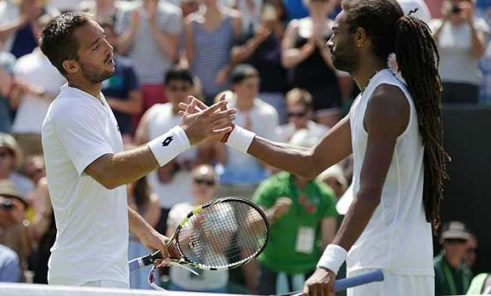 wimbledon 2015 dustin brown crashes out 2 days after