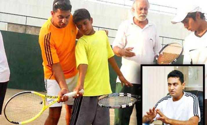 indian birbal wadhera coaches budding tennis players in