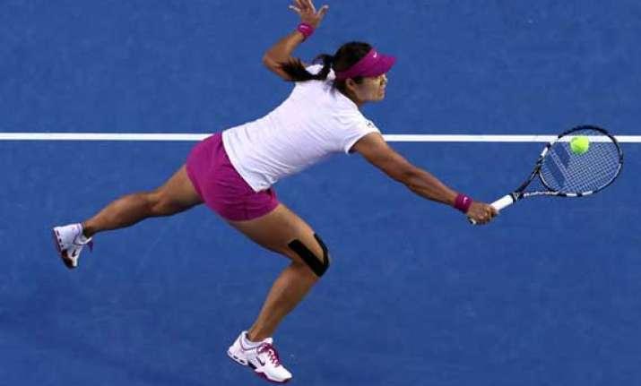 li na wins 1st match after australian open triumph
