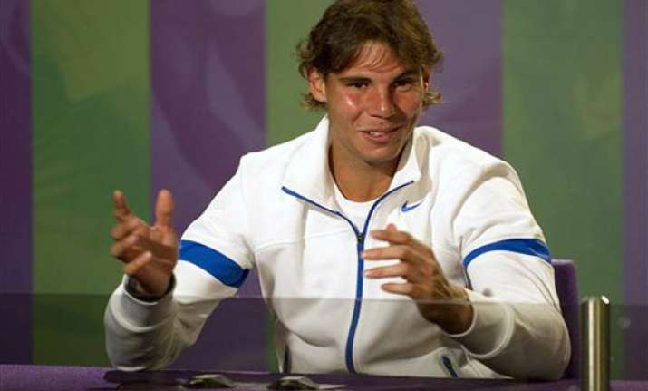nadal says he is far from federer s grand slam record