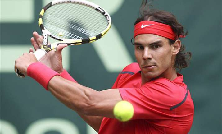 nadal makes winning start on grass at halle