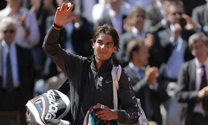 nadal tumbles into french open final