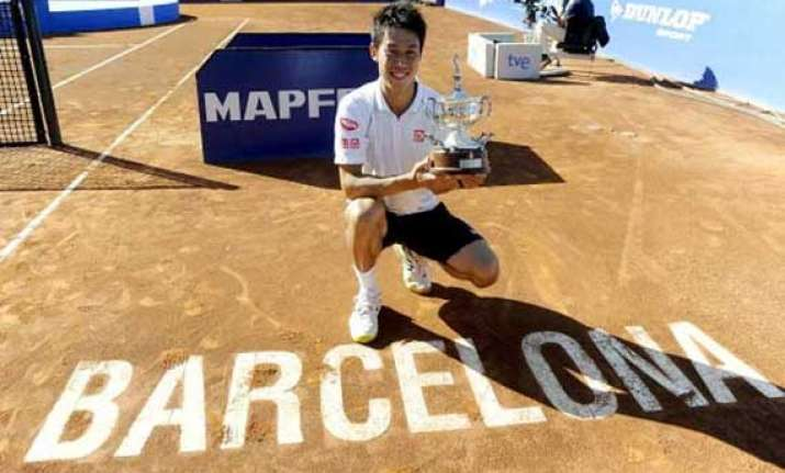 nishikori beats giraldo to win barcelona open