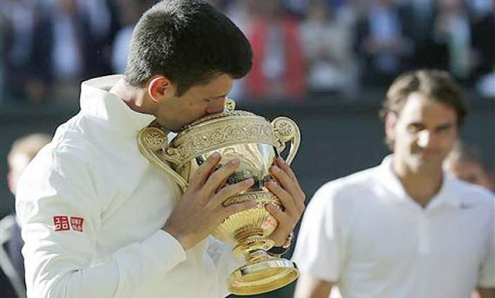 novak djokovic retains singles top spot paes 13th in