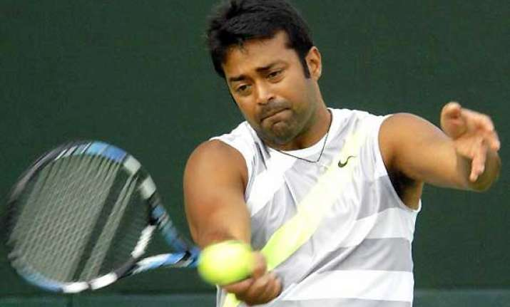 paes peya pair enters french open second round