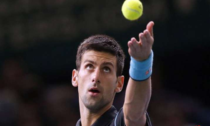 paris masters djokovic beats isner to reach quarterfinals