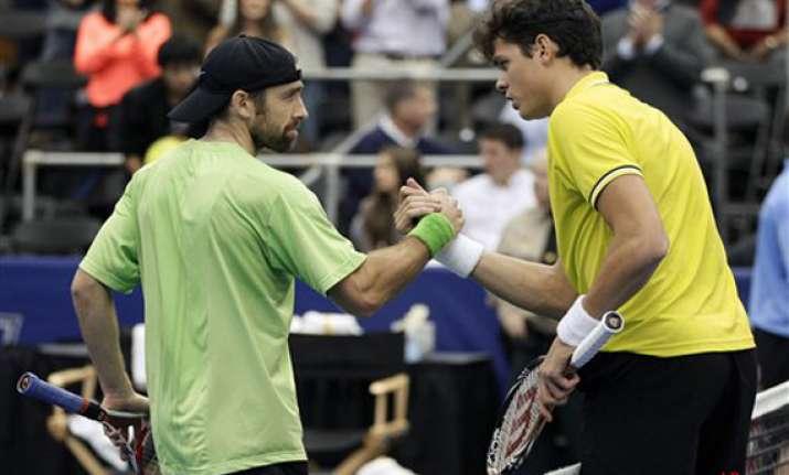 raonic downs becker 6 4 6 4 in memphis semifinal