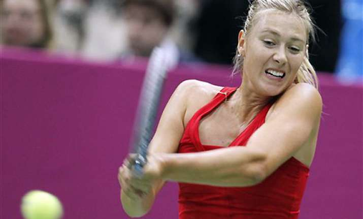 russia leads spain 1 0 as sharapova wins