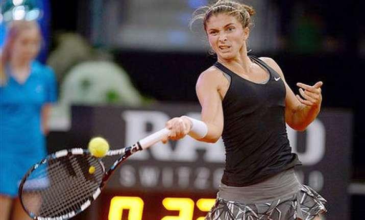 sara errani beats andrea petkovic in 1st round at madrid