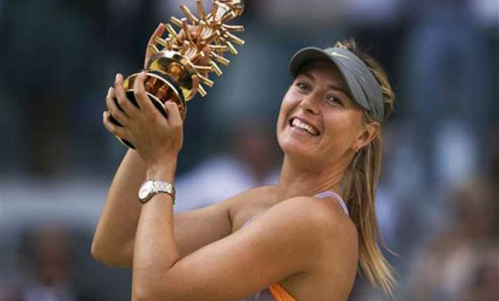 sharapova rallies to beat halep for madrid title